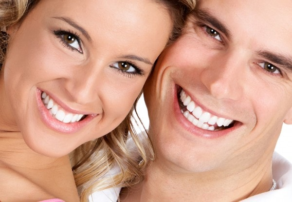 Big smiles on head shots of a man and woman becasue of our quality cosmetic dentistry in Northern VA