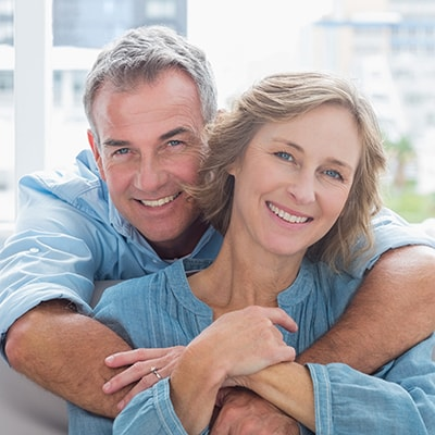 Mature married couple after getting a root canal and a crow