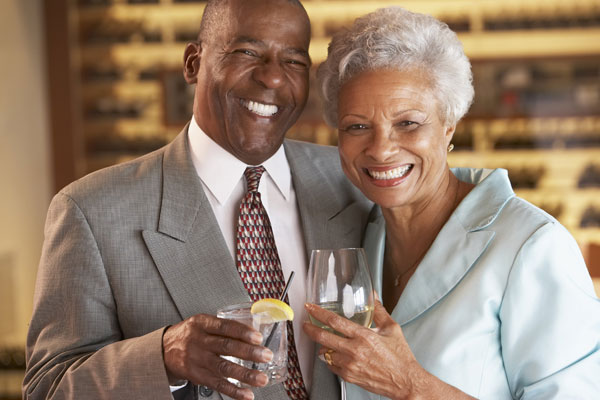 Mature married couple smiling from dental implant in Burke VA