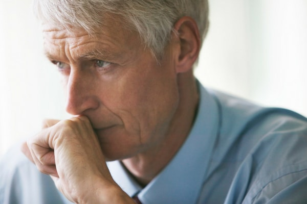 Man worried about his next dental appointment and considering IV sedation